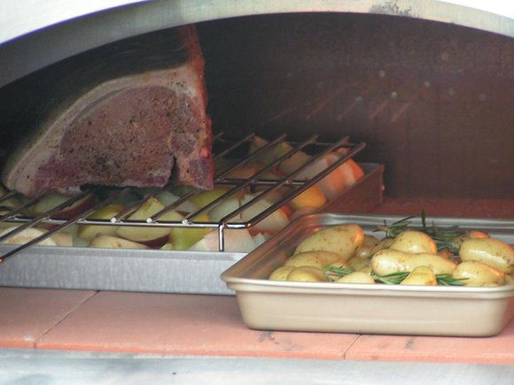 Roast pork, braised vegetables and roast baby potatoes in the Alfa Pizza Oven