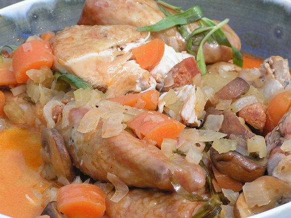 Chicken in white wine and tarragon cooked on the barbecue in the Dutch Oven