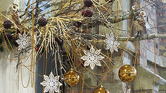 decorated Christmas garland in gold, copper and wood