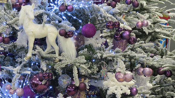 artificial Christmas tree decorated in purple, lilac, white, iridescent and unicorns