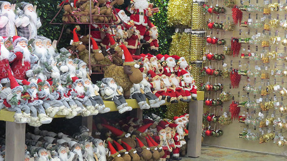 Christmas Santa figures and decorations in red & gold