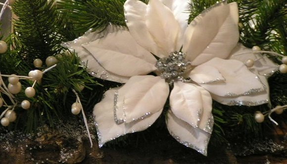 Christmas garland with white glittery poinsettia