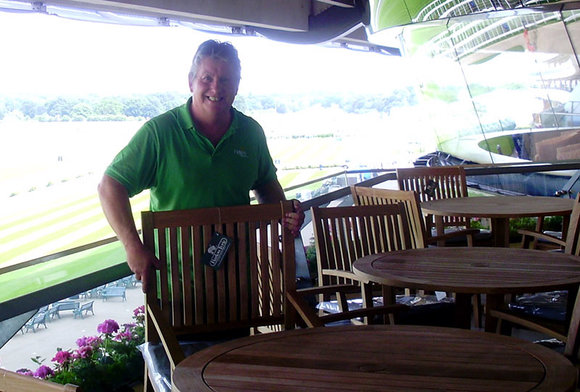 Member of Hayes Garden World staff installing furniture at Ascot racecourse