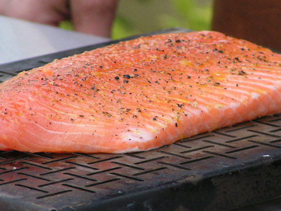 half a salmon on Weber vegetable baskets to cook on the Master-Touch BBQ