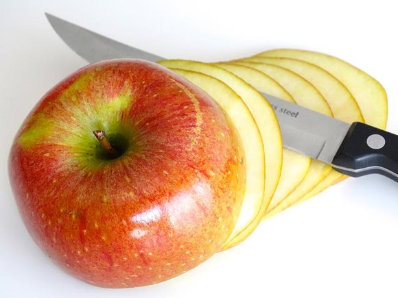 apple being sliced