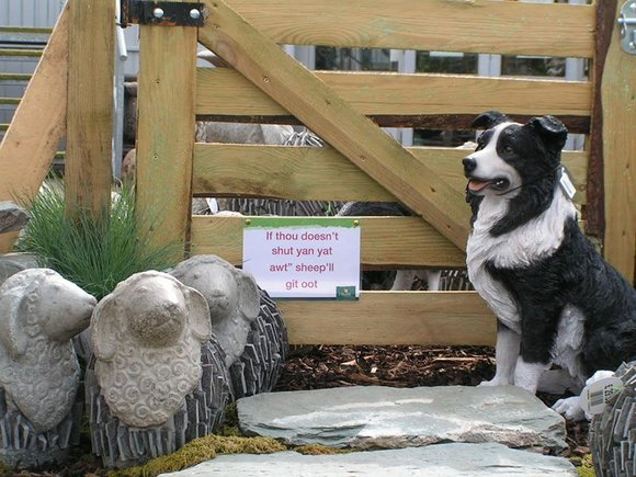 Garden ornaments, stone sheep and sheepdog
