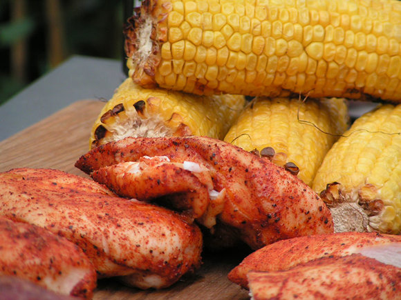 sweet corn and chicken breasts cooked on the Traeger wood pellet grill