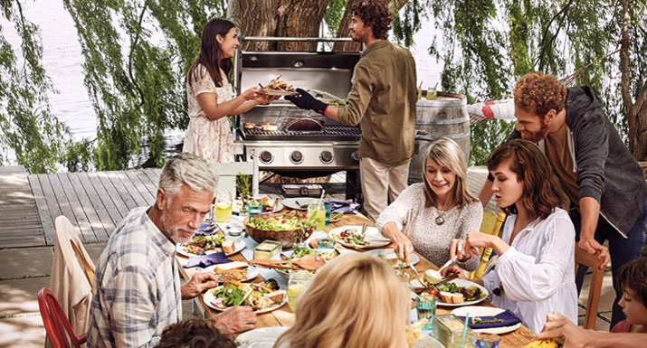 outdoor party with Weber Genesis II gas BBQ