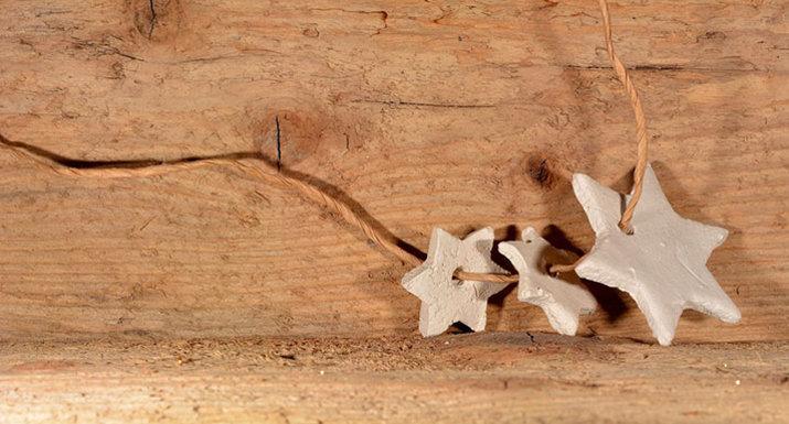 Salt dough Christmas stars threaded on wire
