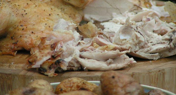 spatchcock chicken & roast potatoes cooked on the Weber Genesis II BBQ