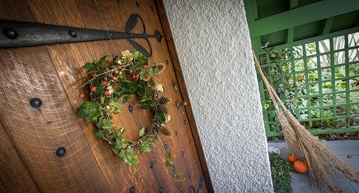 Rustic Christmas wreath hanging on a door