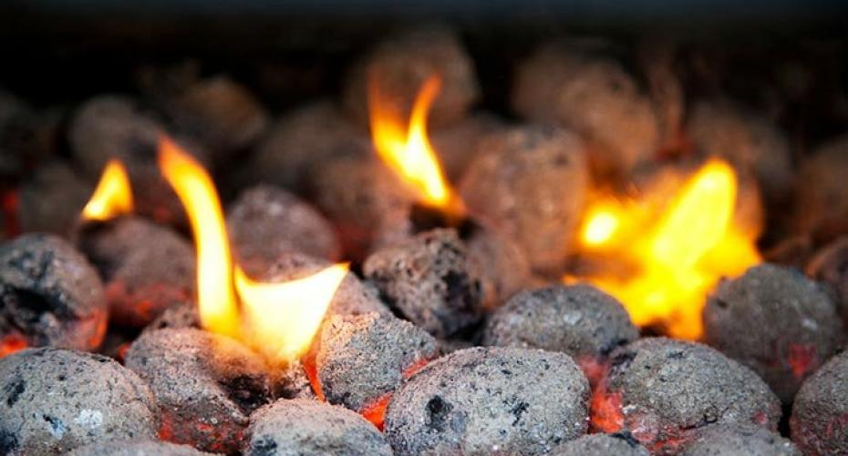 Barbecue briquettes and flames
