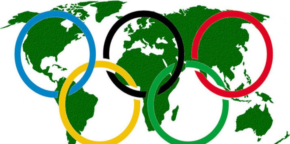 Olympic rings superimposed over map of the world