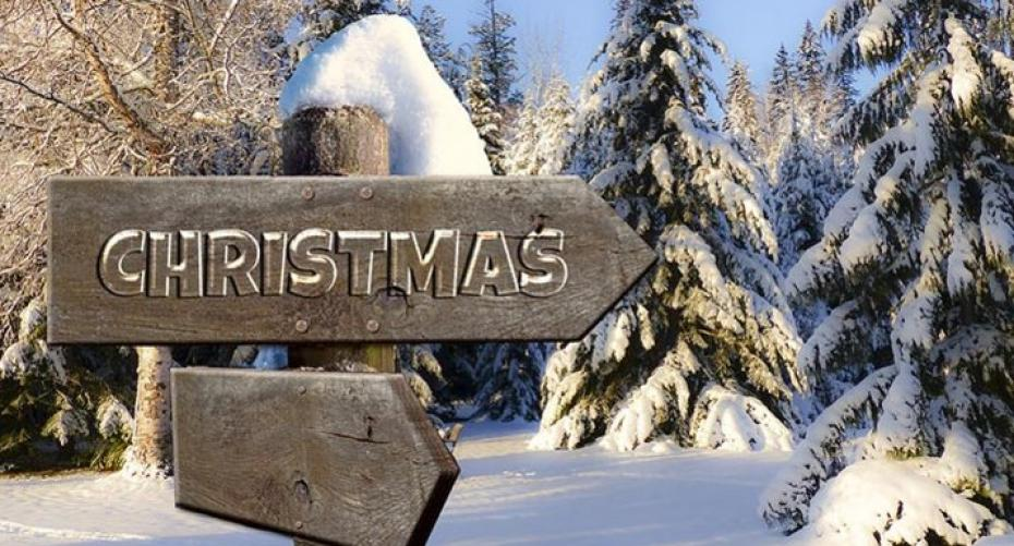 Christmas sign in snowy forest landscape