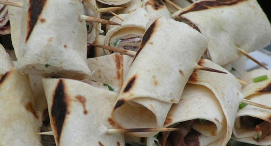 Wraps with Parma ham, cream cheese and chives cooked on BBQ