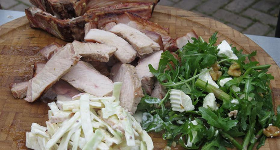 Pork chop with apple slaw and salad cooked on the Weber Go-Anywhere BBQ