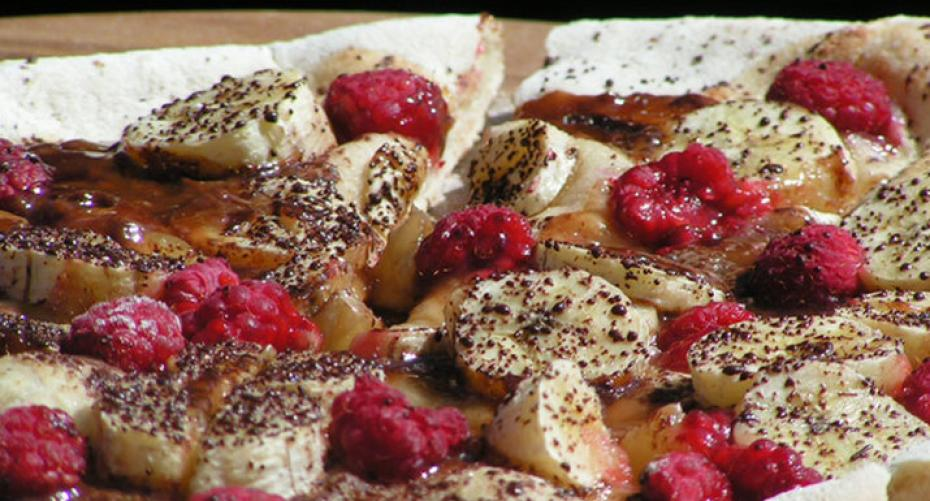 Sweet pizza with raspberries, banana, maple syrup & chololate baked on the Alfa