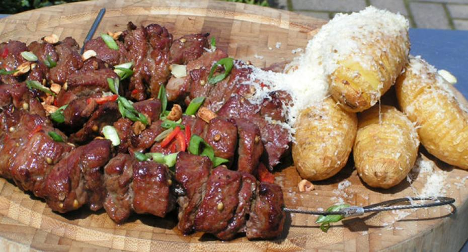 Thai beef skewer & hasselback potatoes cooked on Traeger Timberline 850