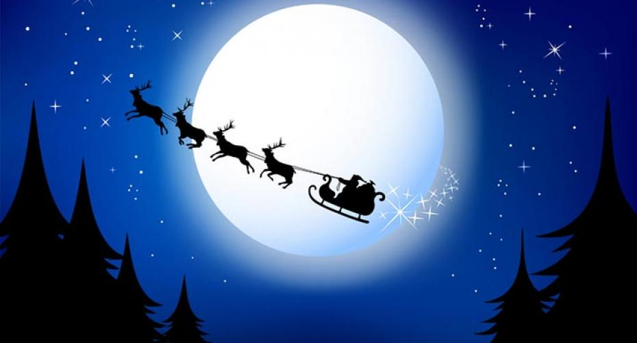 Santa's sleigh flying across the sky