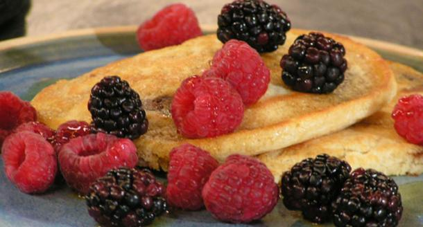 Banana toffee pancakes with raspberries, blackberries and maple syrup