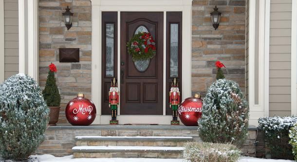 house doorway with snow, Christmas trees, nutcracker soldiers and baubles