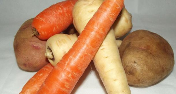 Mixed root vegetables: parsnips, carrots and potatoes