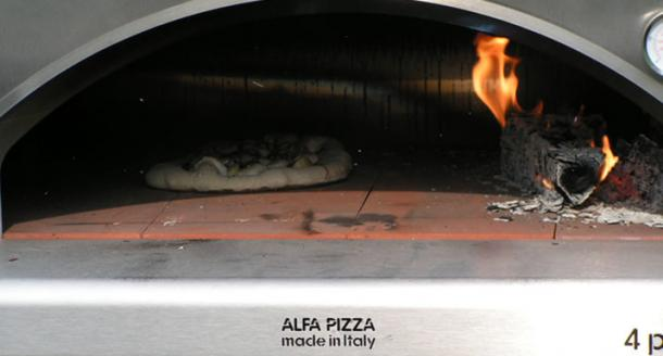Pizza cooking in the Alfa 4 pizze wood fired oven