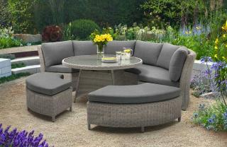 This curved dining set comes and has versatile seating in a light grey resin weave.