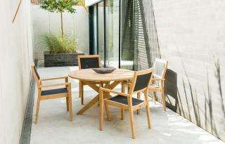 This 1.25m hardwood set has a simple design & the highback sling chairs will stack for storage.