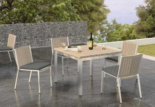 This square weathered teak table with stainless steel frame complements the Monza dining chairs.