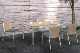The Monza dining chairs complement the rectangular weathered teak table with stainless steel frame.