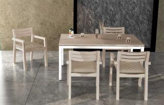 The Singapore armchairs complement the rectangular weathered teak table with stainless steel frame.