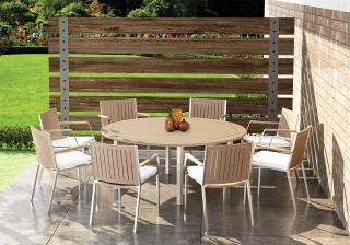 This round weathered teak table with stainless steel frame complements the Monza dining chairs.