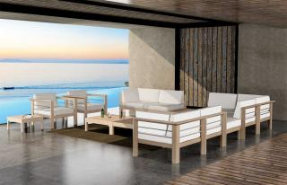 A modular corner lounge set with a weathered teak & stainless steel frame with Sunbrella cushions that can be left out all year.