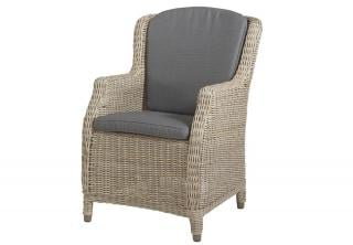 A graceful Hularo Weave dining chair with all weather cushions.