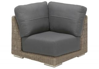 A Pure Hularo Weave modular corner chair in a natural shade with dark grey all weather cushions.