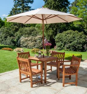 A chunky dining set with parasol which would be ideal for a small patio or garden.
