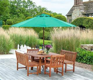 An attractive garden set with a mix of armchair & bench seating for six.