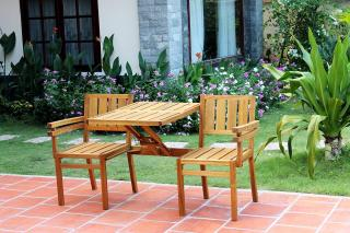 This wooden garden bench also converts to a loveseat with integral table.