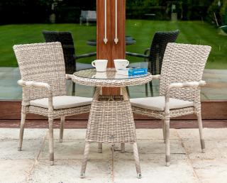 A useful small set for two with a light coloured weave & glass table top.