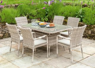 This rectangular set features a casual dining table with stackable dining armchairs.