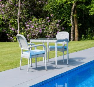 This low maintenance set for two features a choice of resin weave armchairs with a square woven table.