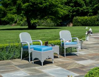 This small low maintenance set features a choice of resin weave armchairs with a woven table.