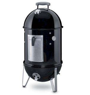 This speciality charcoal grill allows you to smoke food slowly.