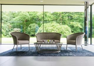 Relax in this low maintenance, curved woven lounge set which comes in a choice of colours & has a glass tabletop.