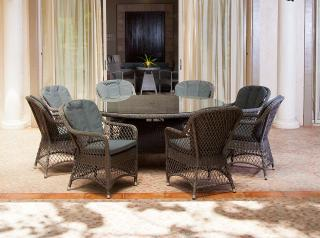This stunning set features open weave armchairs around a glass topped 1.8m woven table.