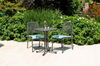 Portofino Round Bistro Set with Side Chairs showing Jade cushions
