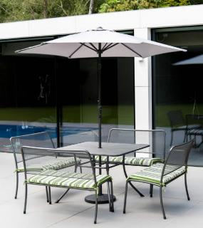 A powder coated, tubular steel & wire mesh set for eight with bench seating & parasol.
