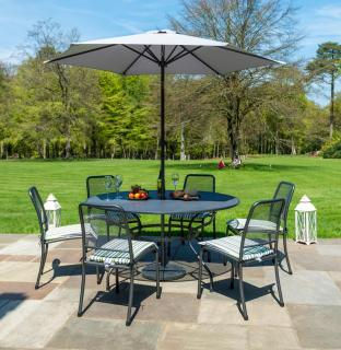 A powder coated, tubular steel & wire mesh set for six with parasol, base & stacking side chairs.