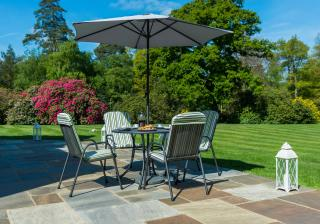 This powder coated, tubular steel & wire mesh table comes with a parasol & base with high back armchairs.